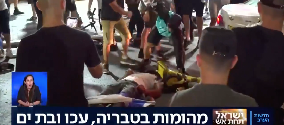 'We're watching a lynching': Jewish crowd in Israel beats Arab man as country erupts in unrest