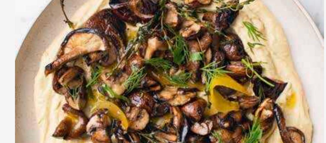 Confit garlic hummus with grilled mushrooms