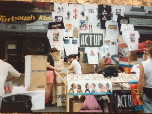 Charles Hovland, ACT UP member, sells t-shirts at Gay Pride in 1992. by the Forward