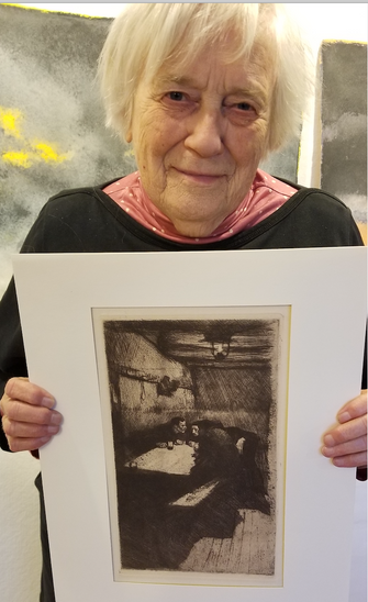 Artist And Inspiration: Claire Van Vliet poses with a Kollwitz print